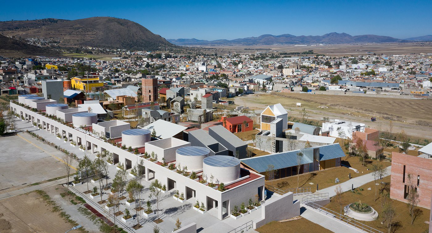 The Apan Housing Laboratory is a low-cost social housing project located in the city of Apan, Mexico. The campus of house prototypes explores solutions for affordable housing, which is needed in a country where only 13% of newly built homes in 2019 were considered affordable for households earning around three times the minimum wage. (Photo: p86, The Ideal City)