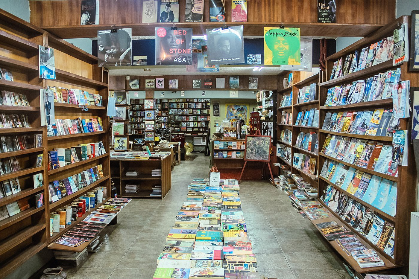 The wooden shelves of The Jazzhole are stuffed with new and secondhand novels, non-fiction books, comics, and magazines. (Pho