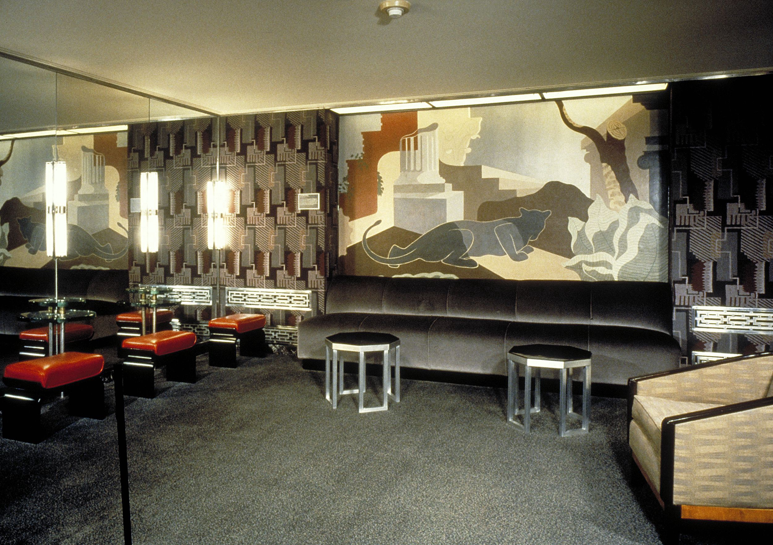 The panther mural by Henry Billings is located in the Ladies Powder Room on the third floor of Radio City Music Hall.