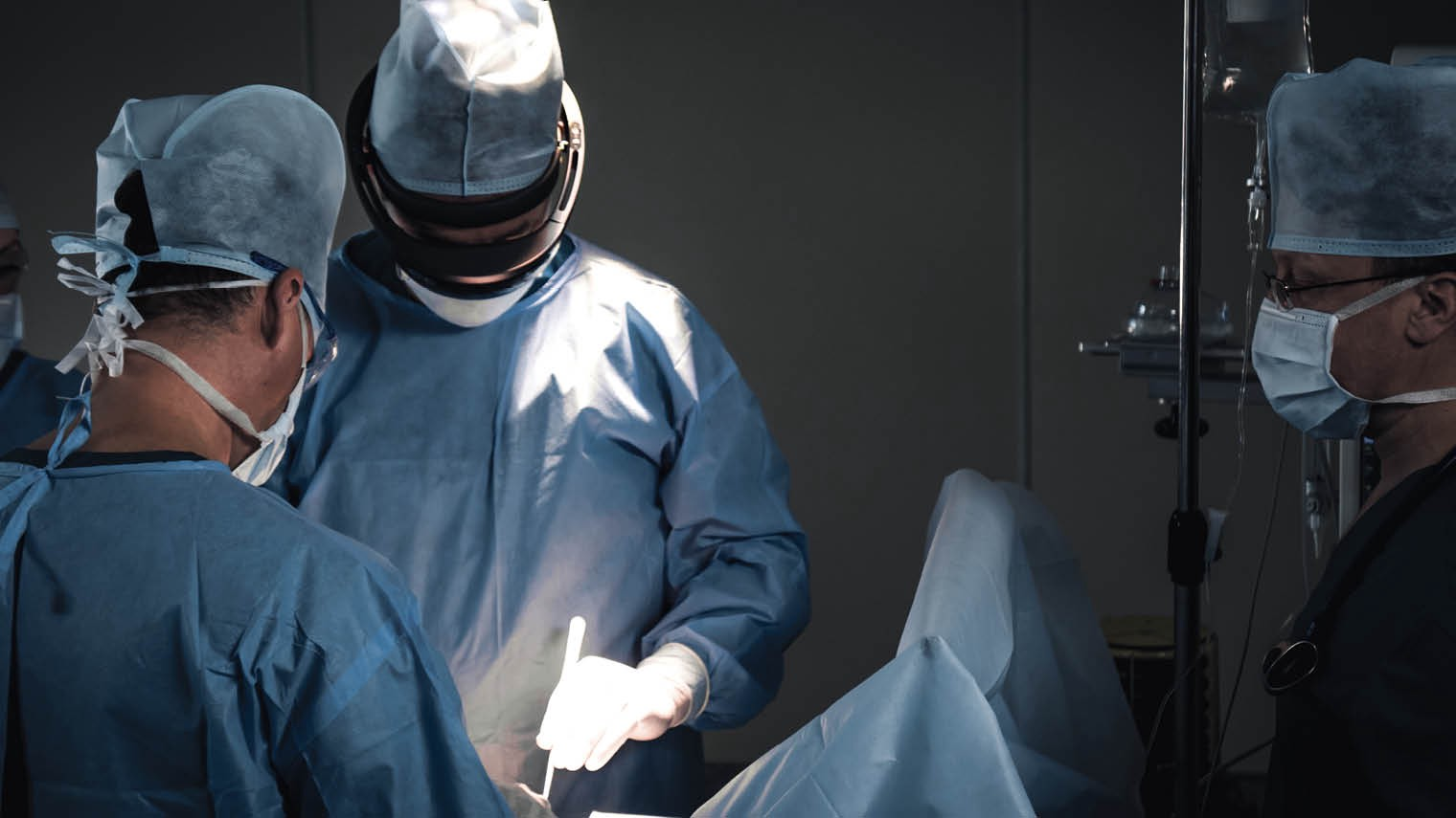 Surgeons performing an operation with an augmented reality (AR) headset
