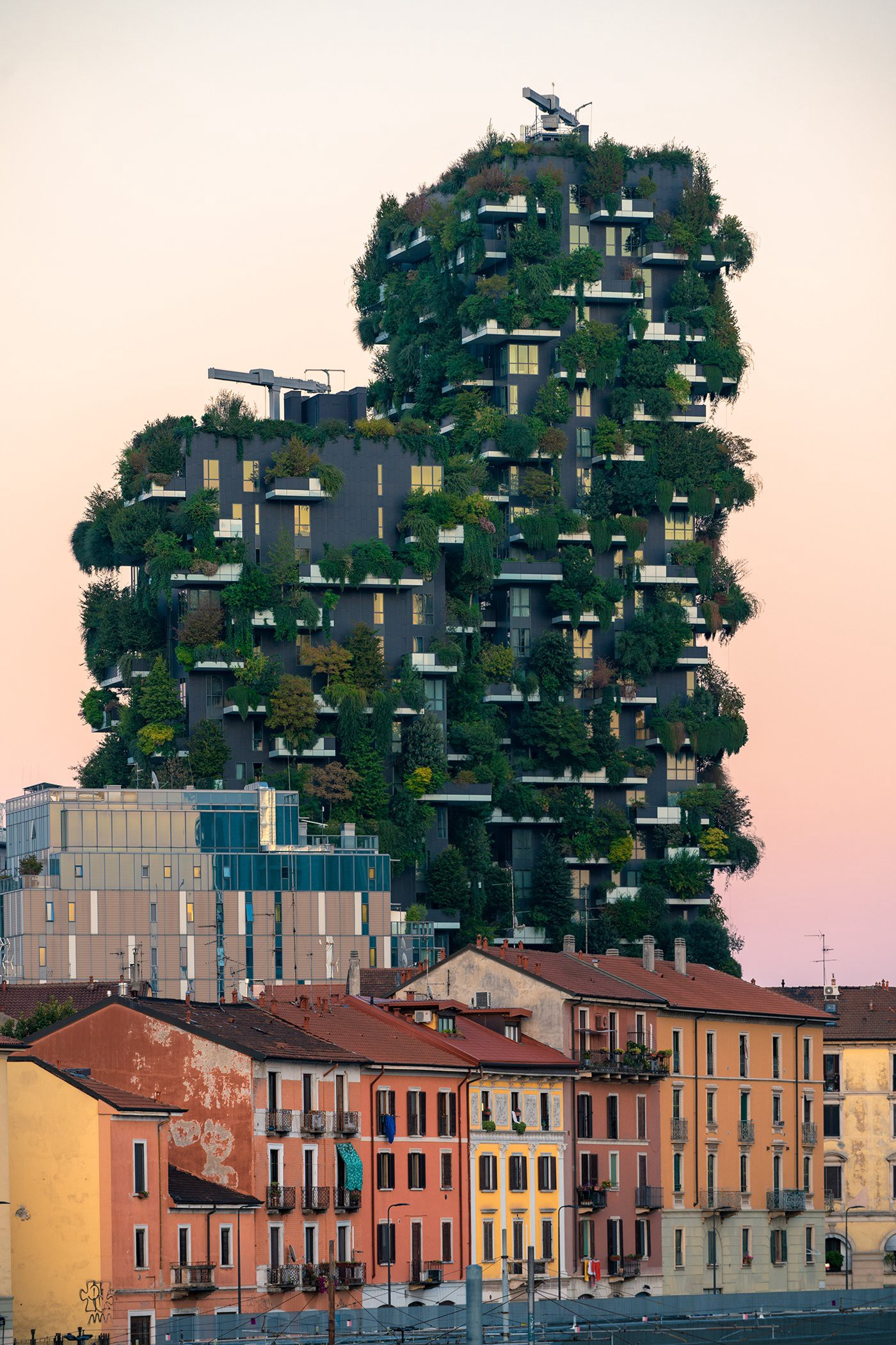 Representing a new urban habitat, Bosco Verticale ( Vertical Forest) is a pioneering prototype for the future of green housing. Measuring 80 and 112 meters (262 and 367 feet) in height, the towers support almost 800 trees. (Photo: Stefano Boeri Architetti, Evergreen Architecture)