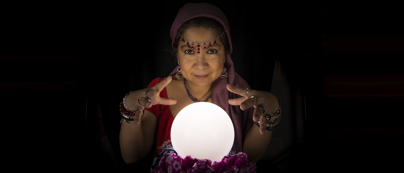Fortune teller with a luminous crystal ball