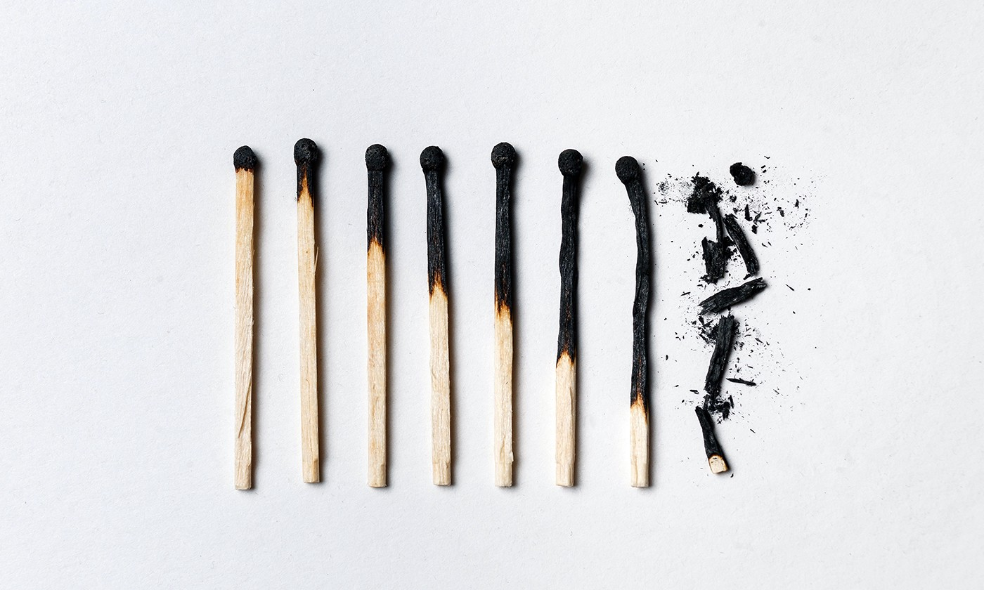 eight matches lie next to each other ranging from just the tip burnt to completely burnt out and shattered