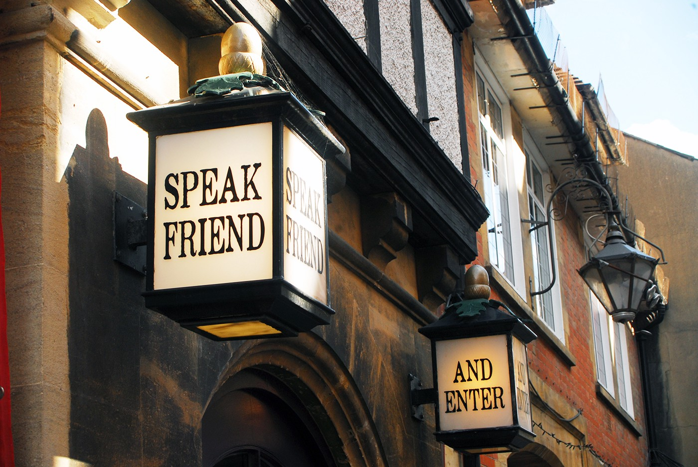 Two large lanterns above a doorway inscribed with the words: Speak Friend and Enter