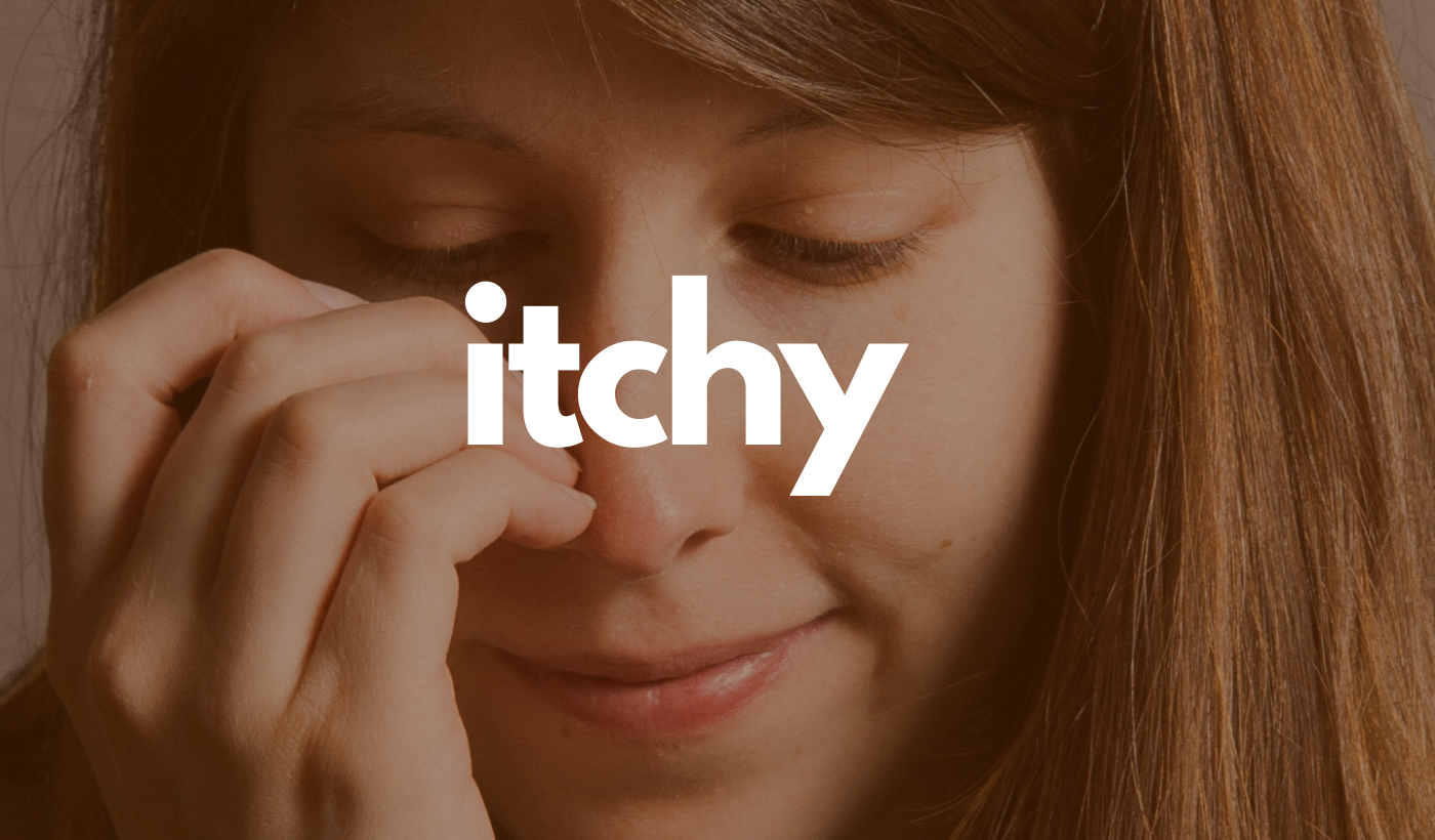 Itchy header: Woman scratching face