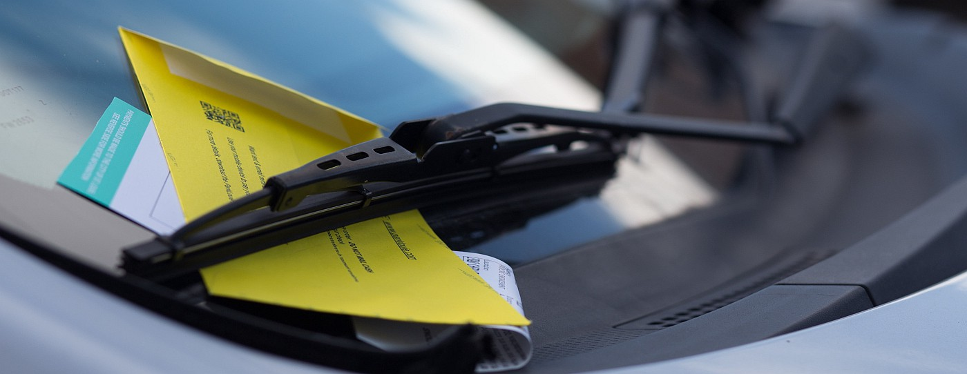 Parking ticket behind windscreen wiper