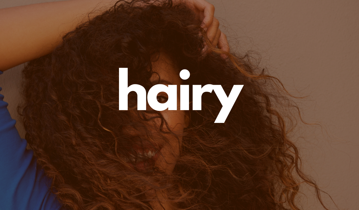 Hairy header: Woman with hair covering her face