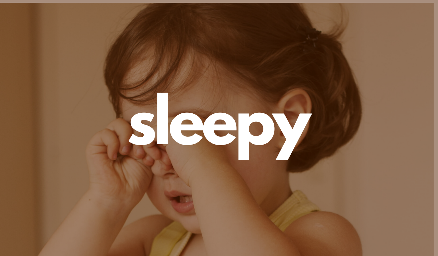 Sleepy header: Toddler rubbing eyes