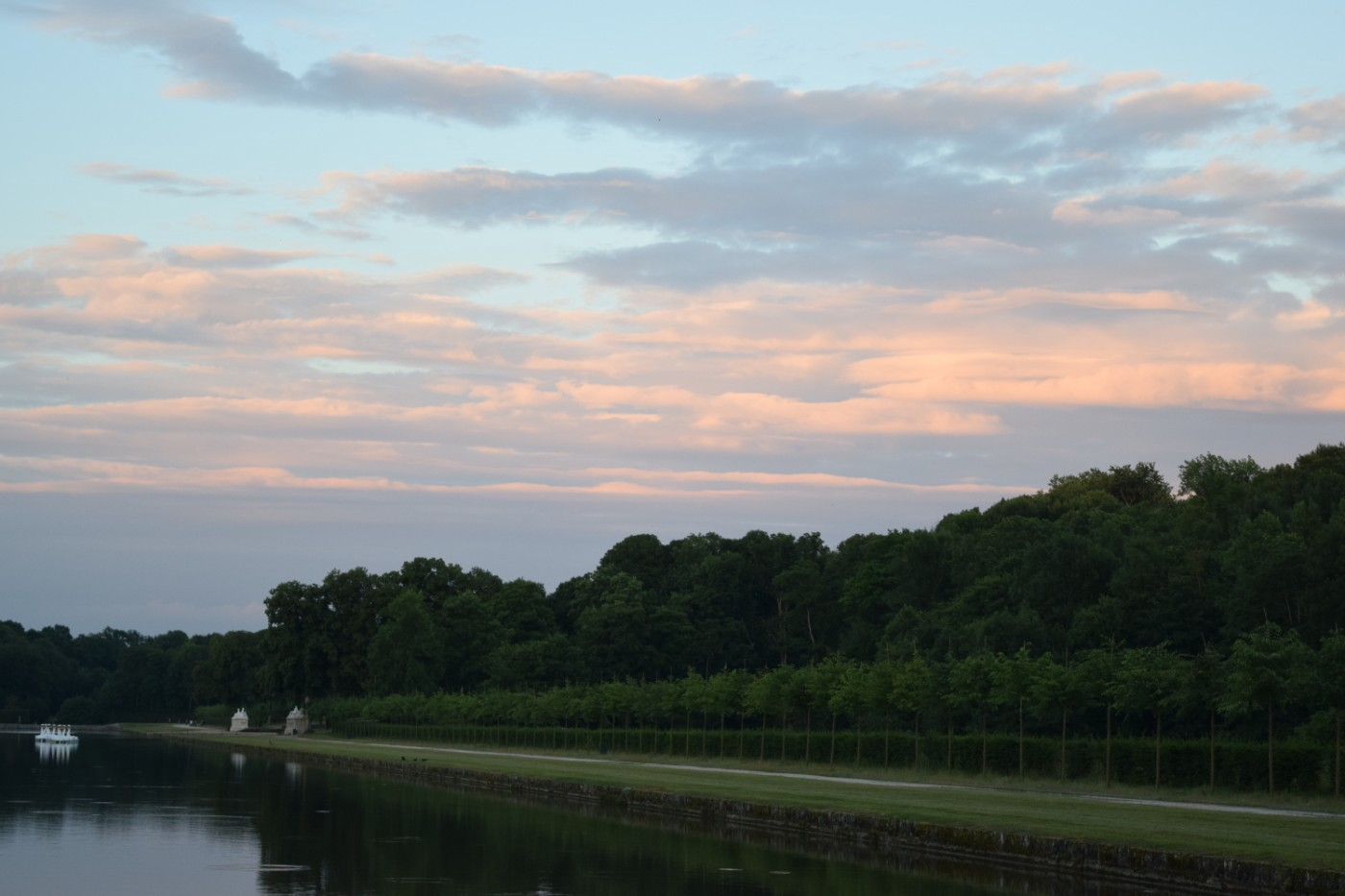 Swan boats floating under cotton-candy skies just outside the Château de Vaux-le-Vicomte.