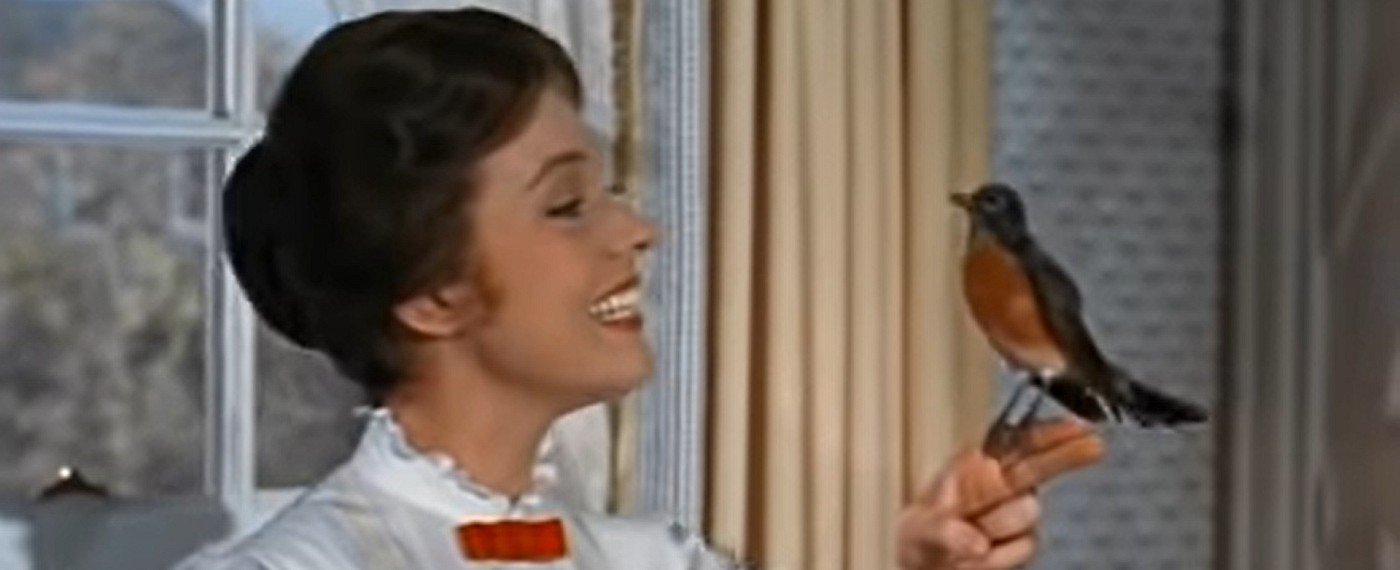 Screenshot from Mary Poppins — Ms Poppins with a robin on her finger