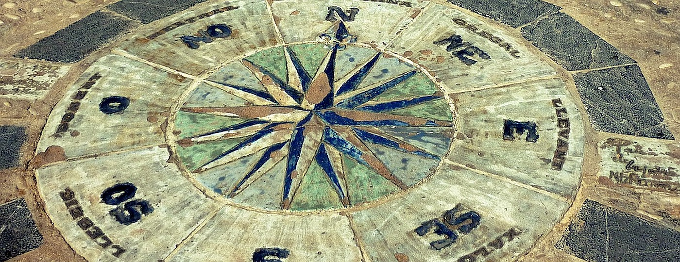 An ancient compass made of painted floor tiles