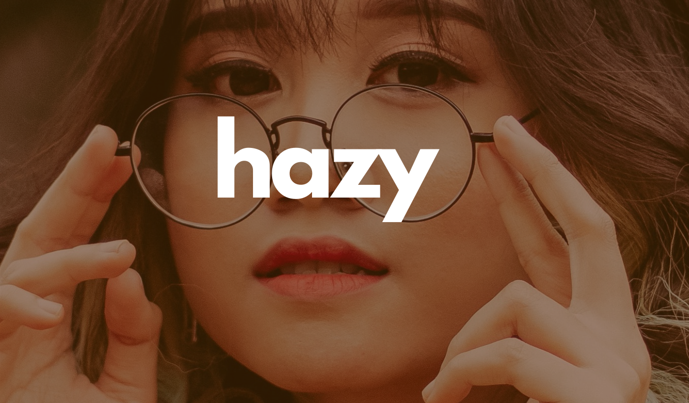 Hazy header: Woman adjusting her eyeglasses