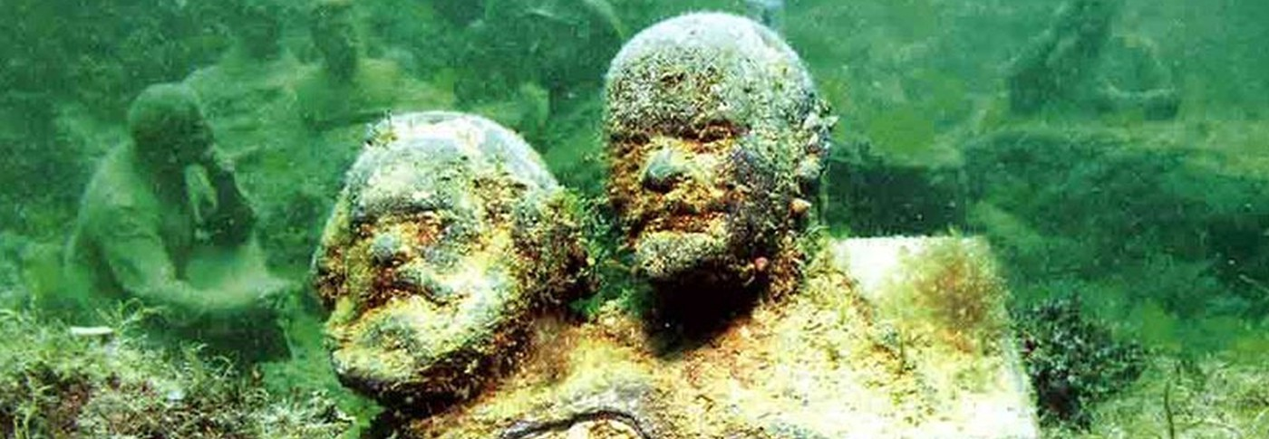 Bust of Marx and Lenin submerged on the bottom of the sea