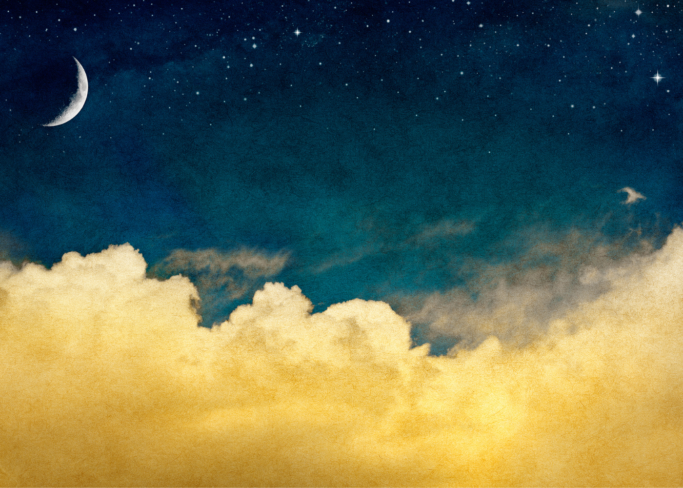 Crescent moon in night sky above cloud