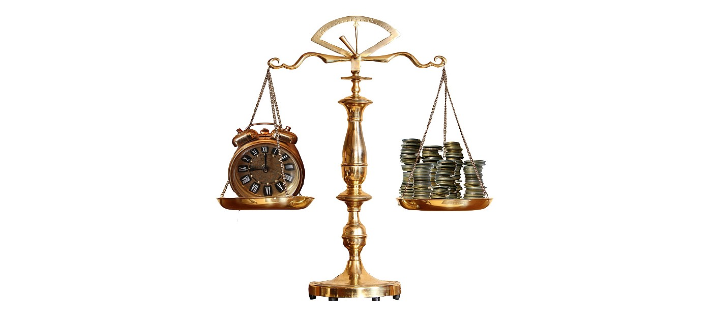 A set of old fashioned scales with a clock on one side and piles of money on the other