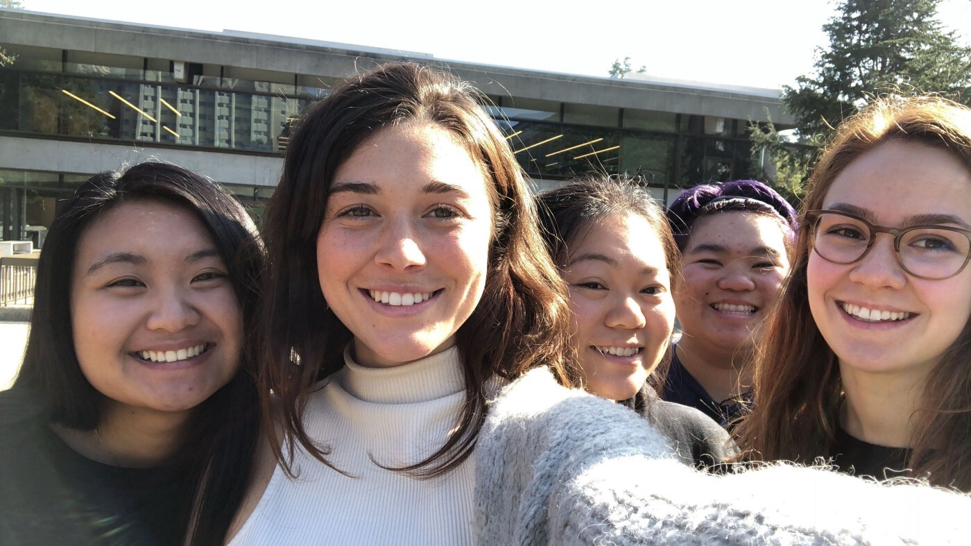 Five young women pose for a selfie.