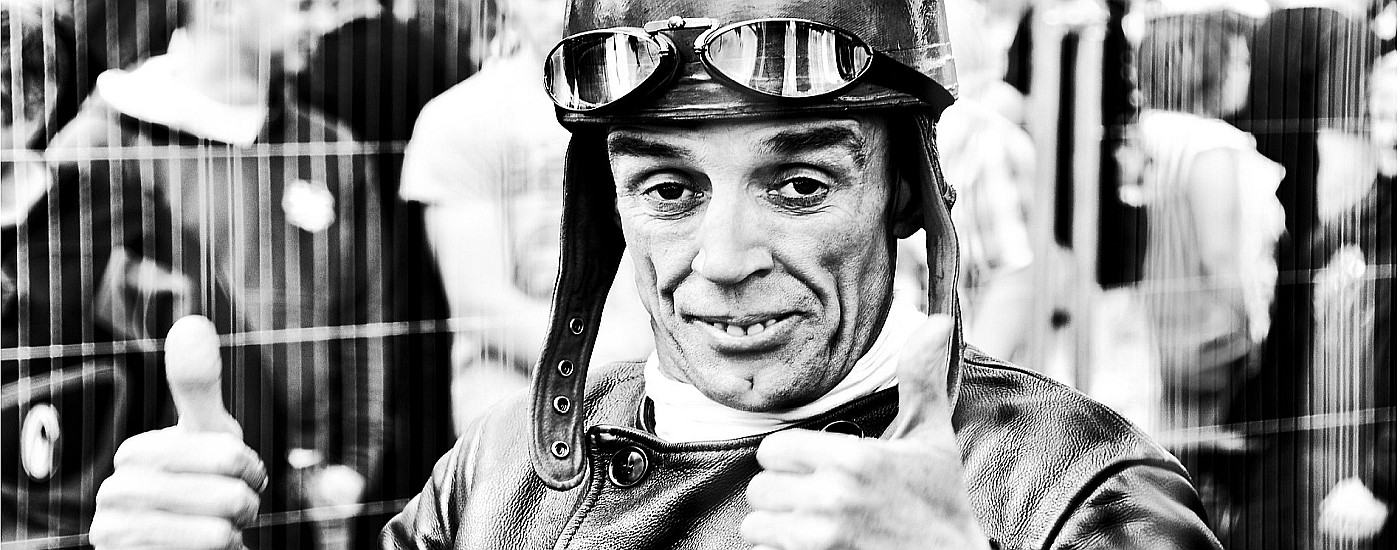Old fashioned racer holding up both thumbs