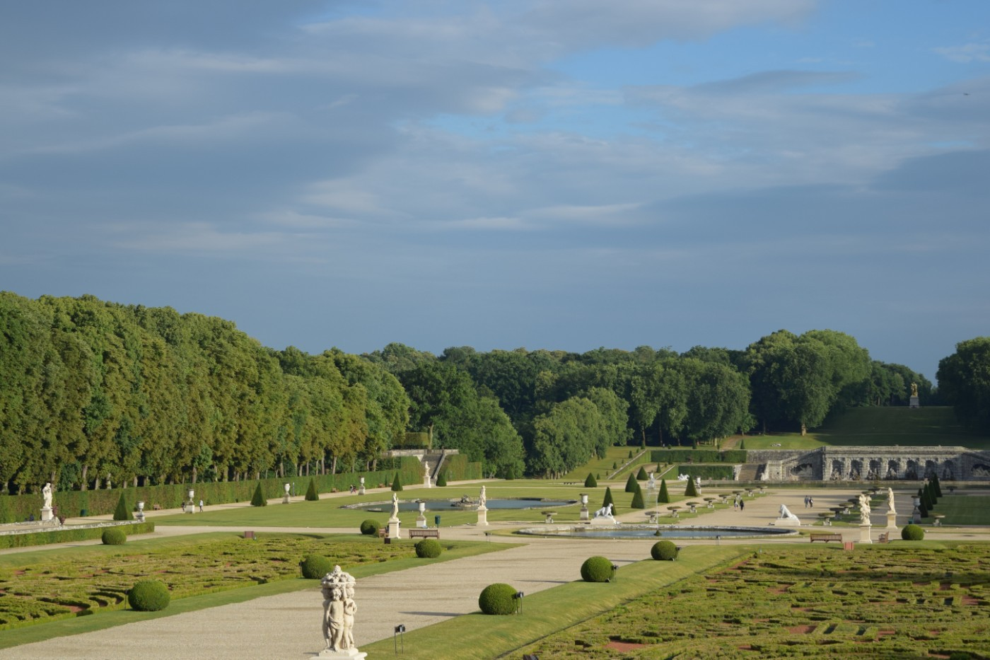The statues, hedges, ponds, trees, alleys, and grotto of the grounds of the Château de Vaux-le-Vicomte.