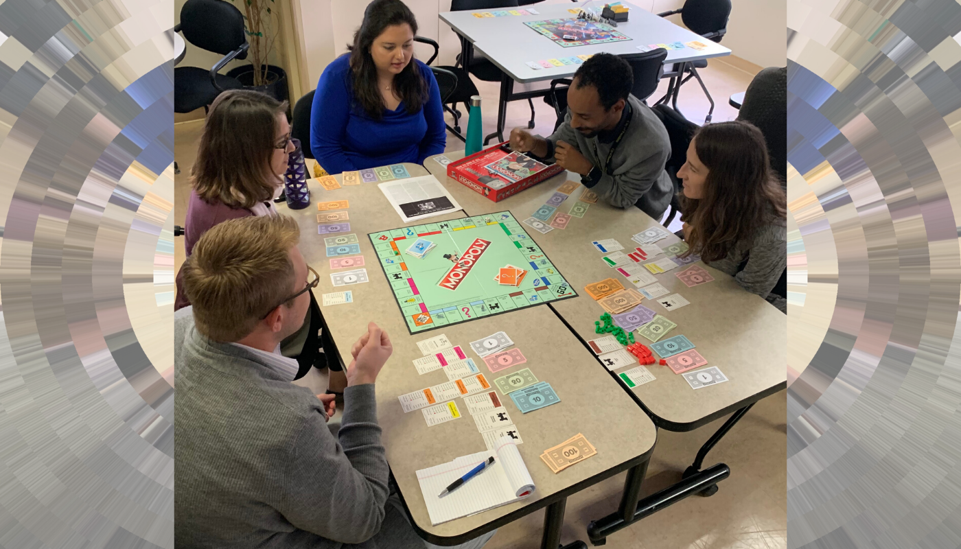 "Photo of 5 participants playing monopoly as part of the ""Equity Monopoly"" activity in Pasadena's health department, Nov 2019."
