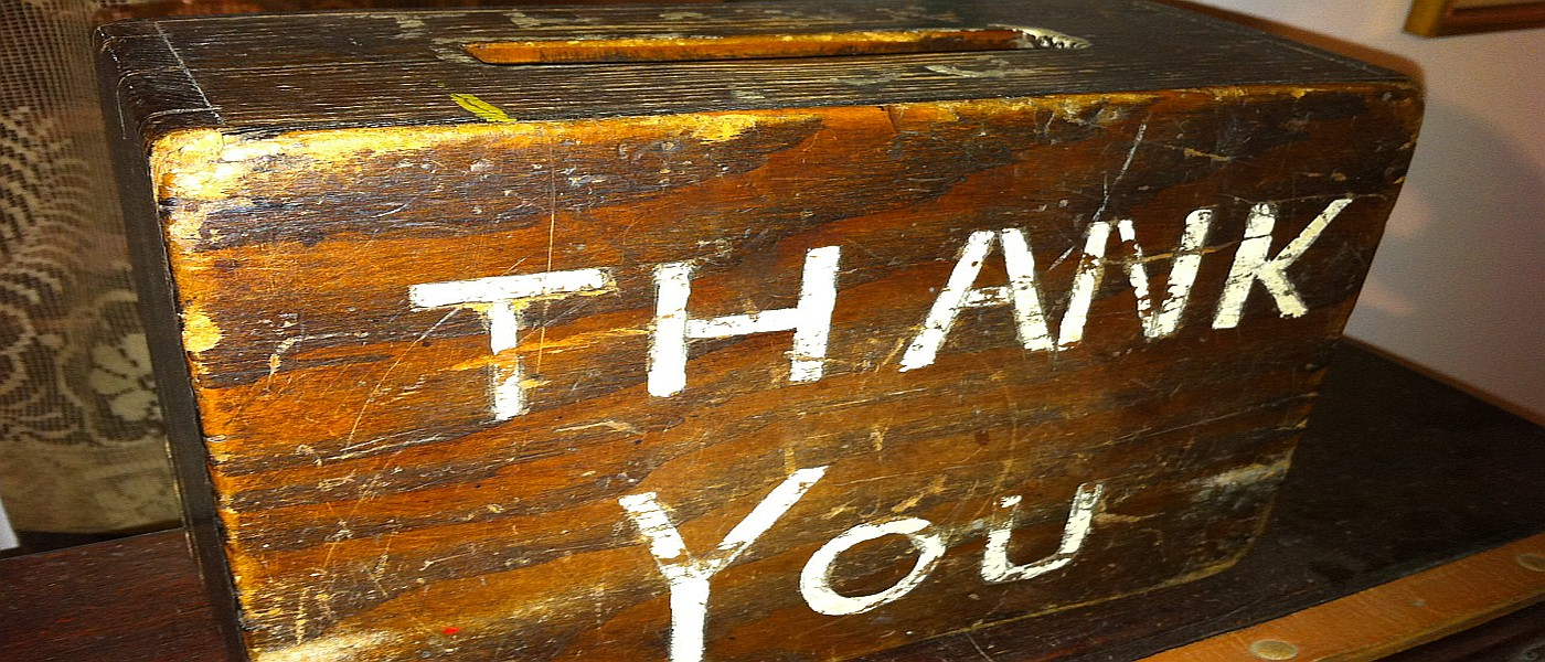 Wooden collection box with the inscription 'Thank You'