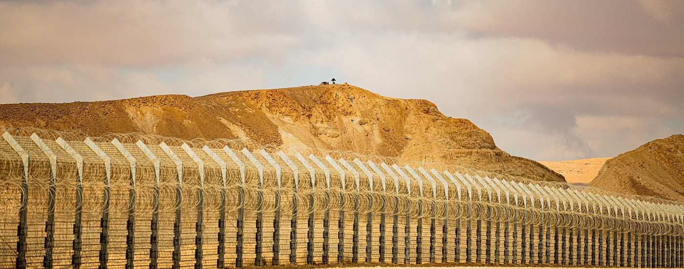 A heavily fortified border with barbed wire
