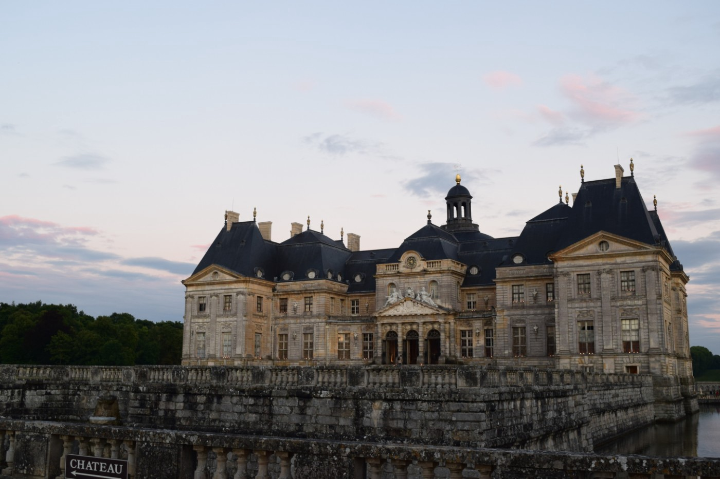 A summer evening at the Château de Vaux-le-Vicomte, seen here with its moat.