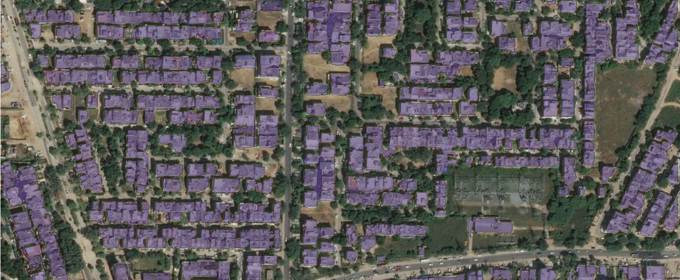 a satellite image with building footprints polygons drawn on the buildings
