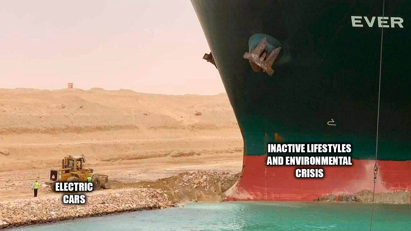 A meme pic showing the bow of the enormous ship Ever Given with the words 'Inactive lifestyles and environmental crisis.' on it. The tiny earth mover on the ground in front has the words 'Electric cars' under it.