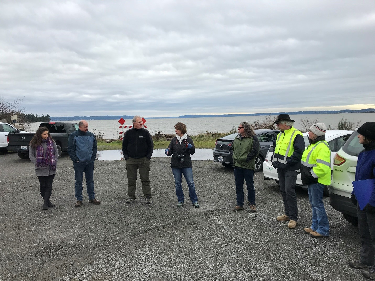 Photo of stakeholders discussing a possible project at Livingston Bay. Photo credit: Laura Ferguson.