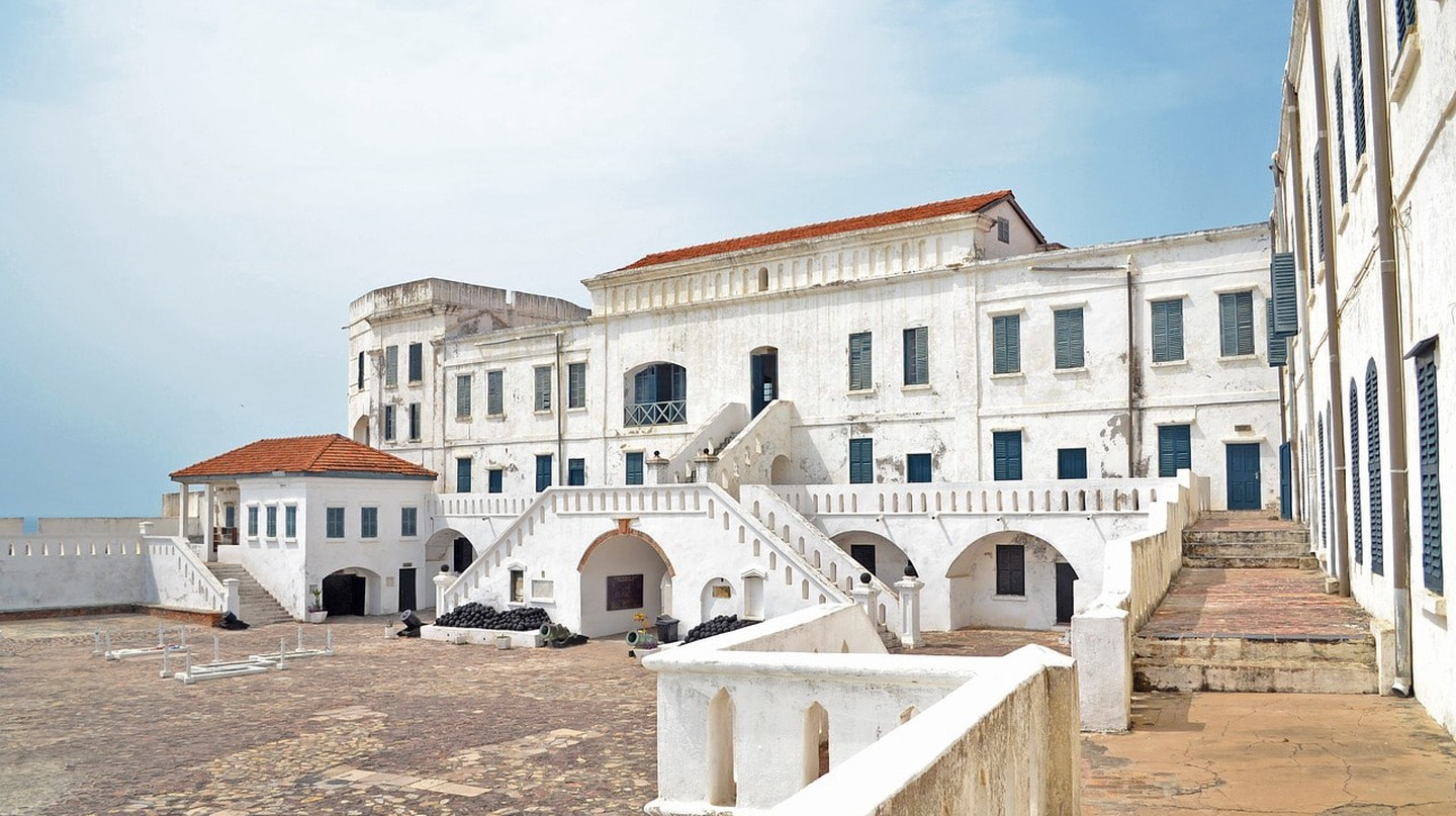 Cape Coast Castle in Ghana with a weathered white facade.
