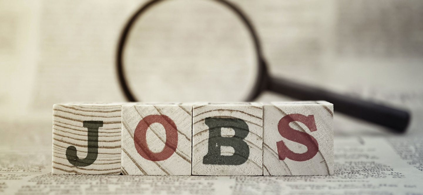 """Wooden block spelling out """"JOBS"""""""