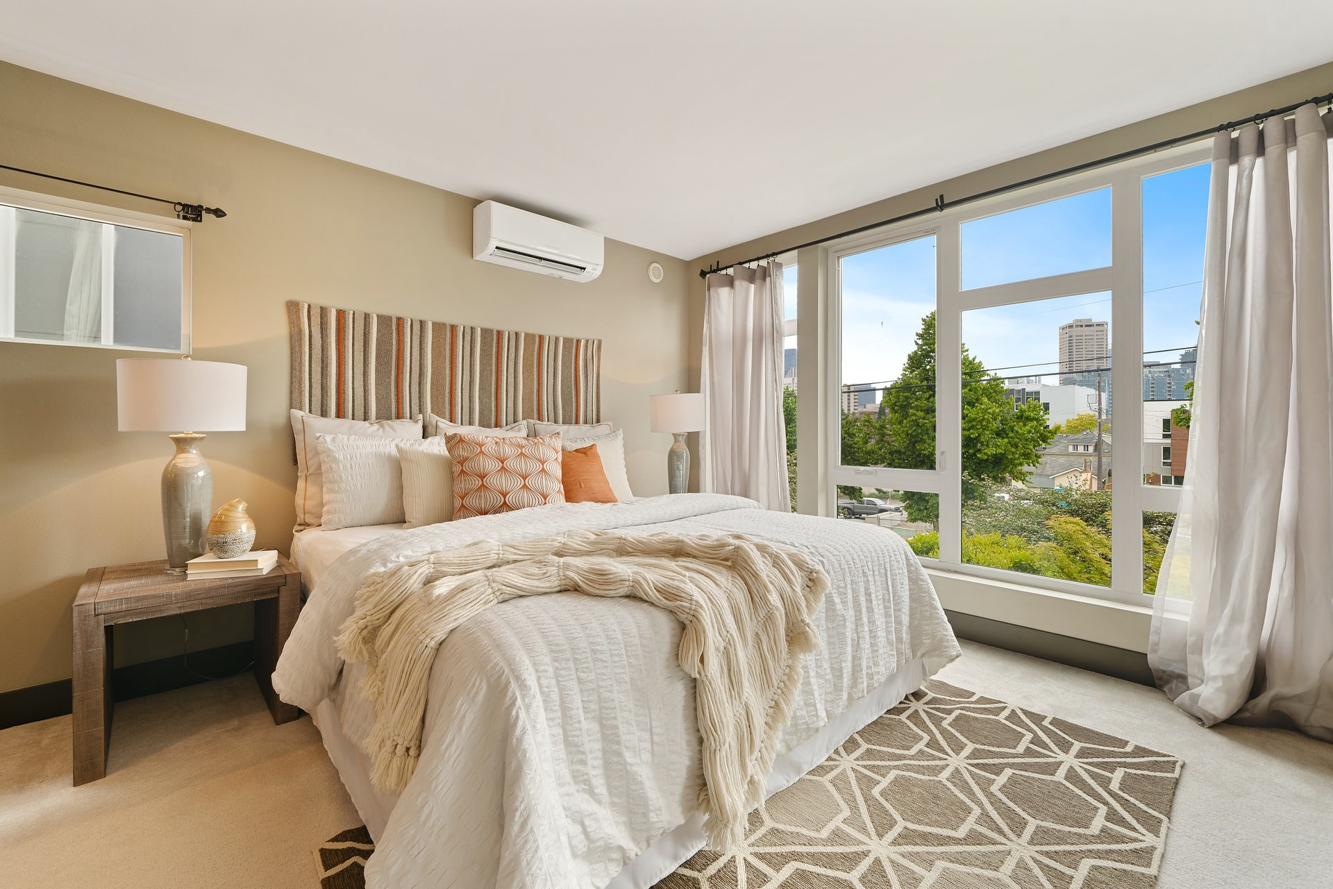 Large bedroom with double bed and a view of trees
