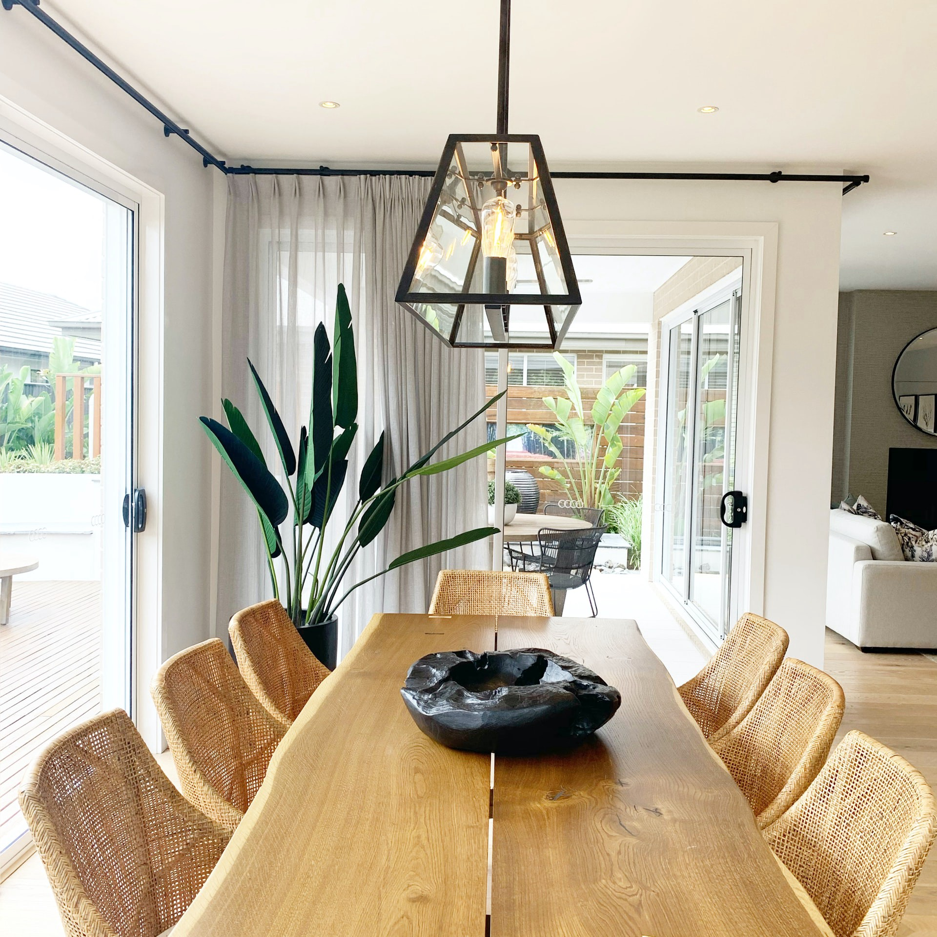 Wooden dining table with modern light fixture