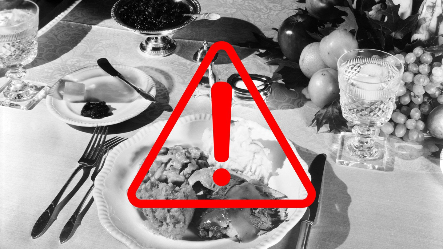 Black-and-white vintage photo of a Thanksgiving dinner; overlaid on it is a red triangle with an exclamation mark.