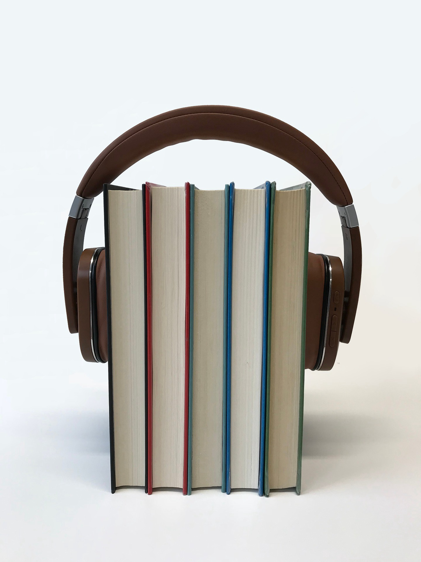 Headphones + books | Photo by sindrehsoereide from Pixabay