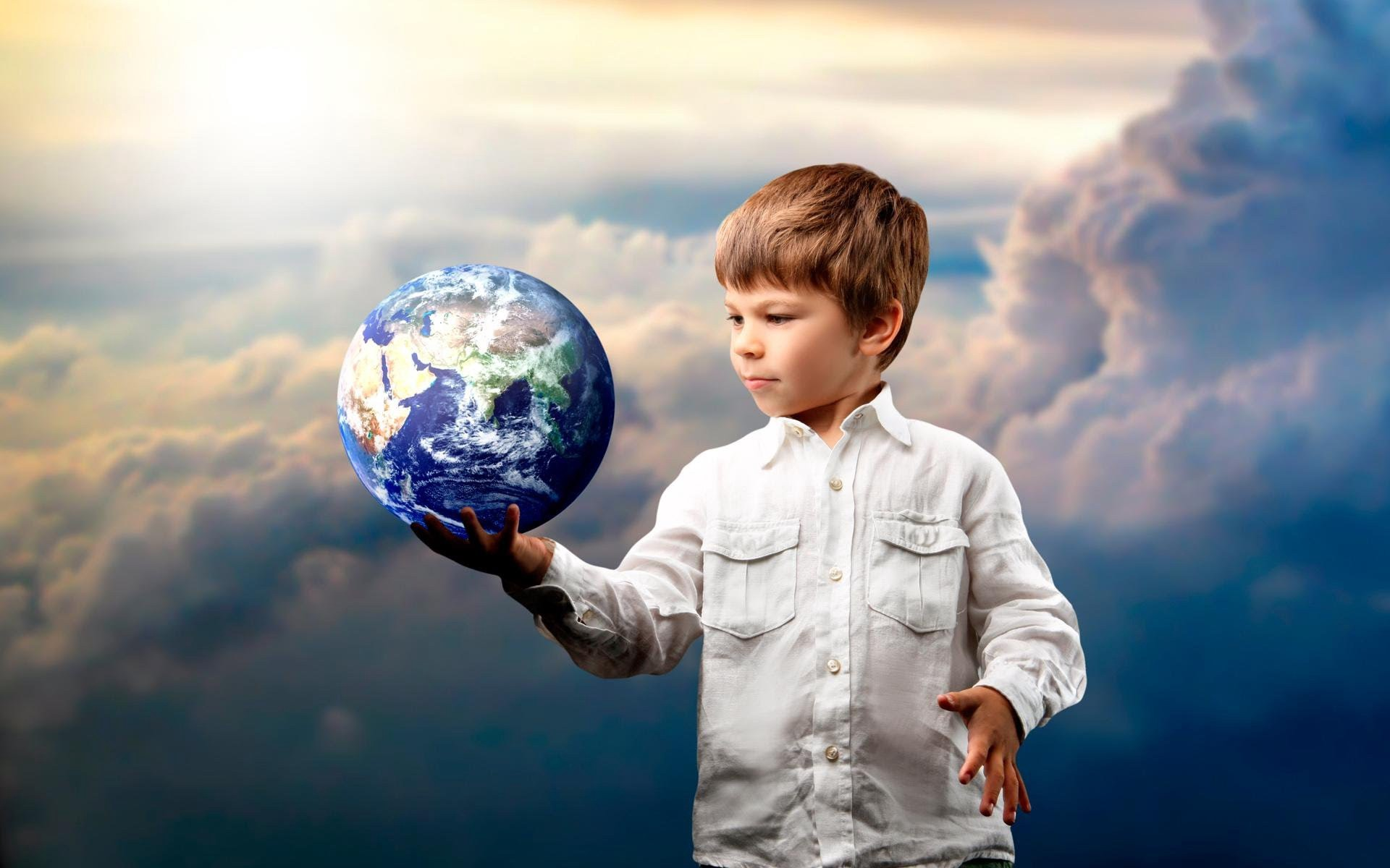 Photography of a kid holding a globe