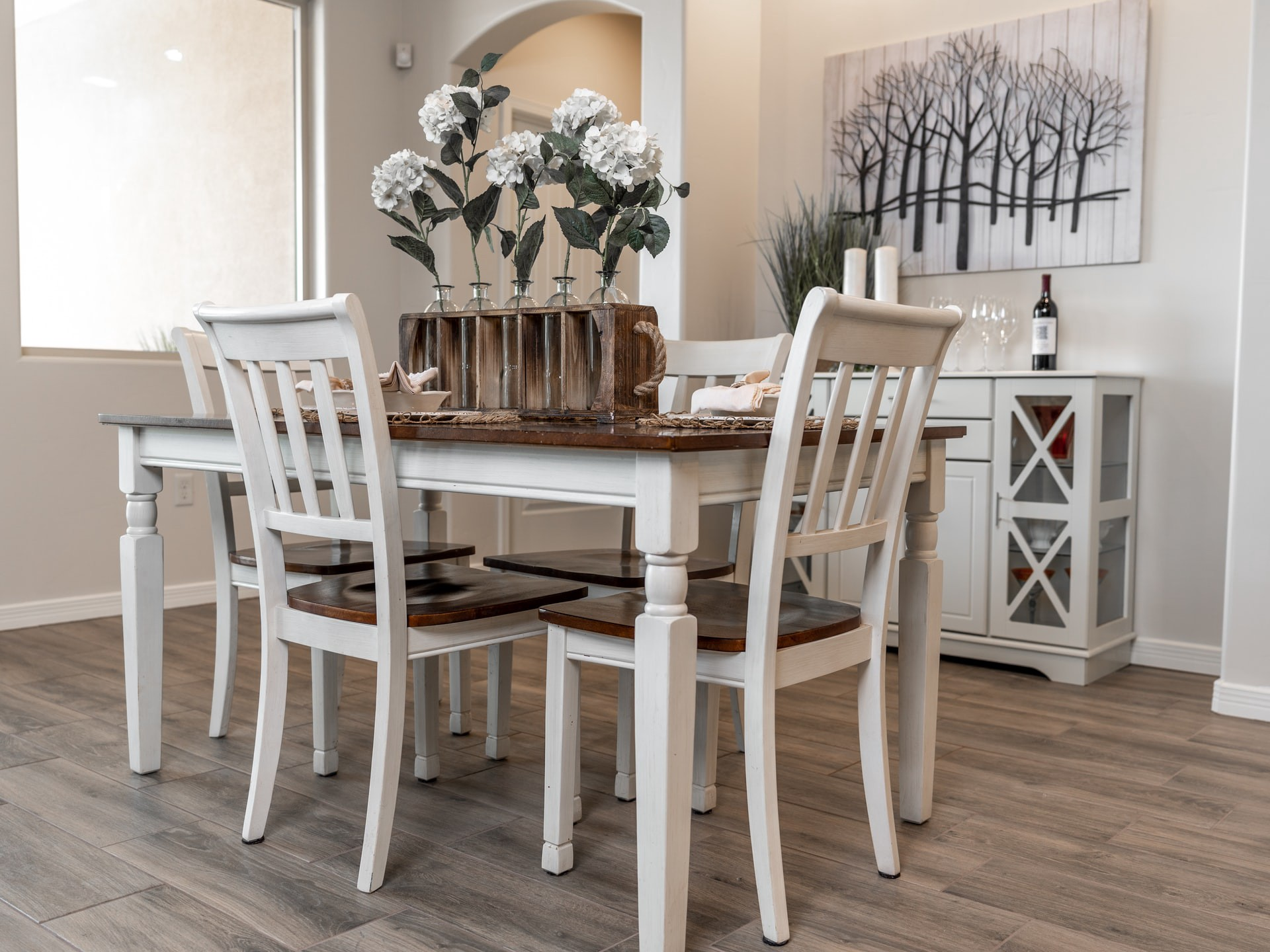 White table and chair set in dining room