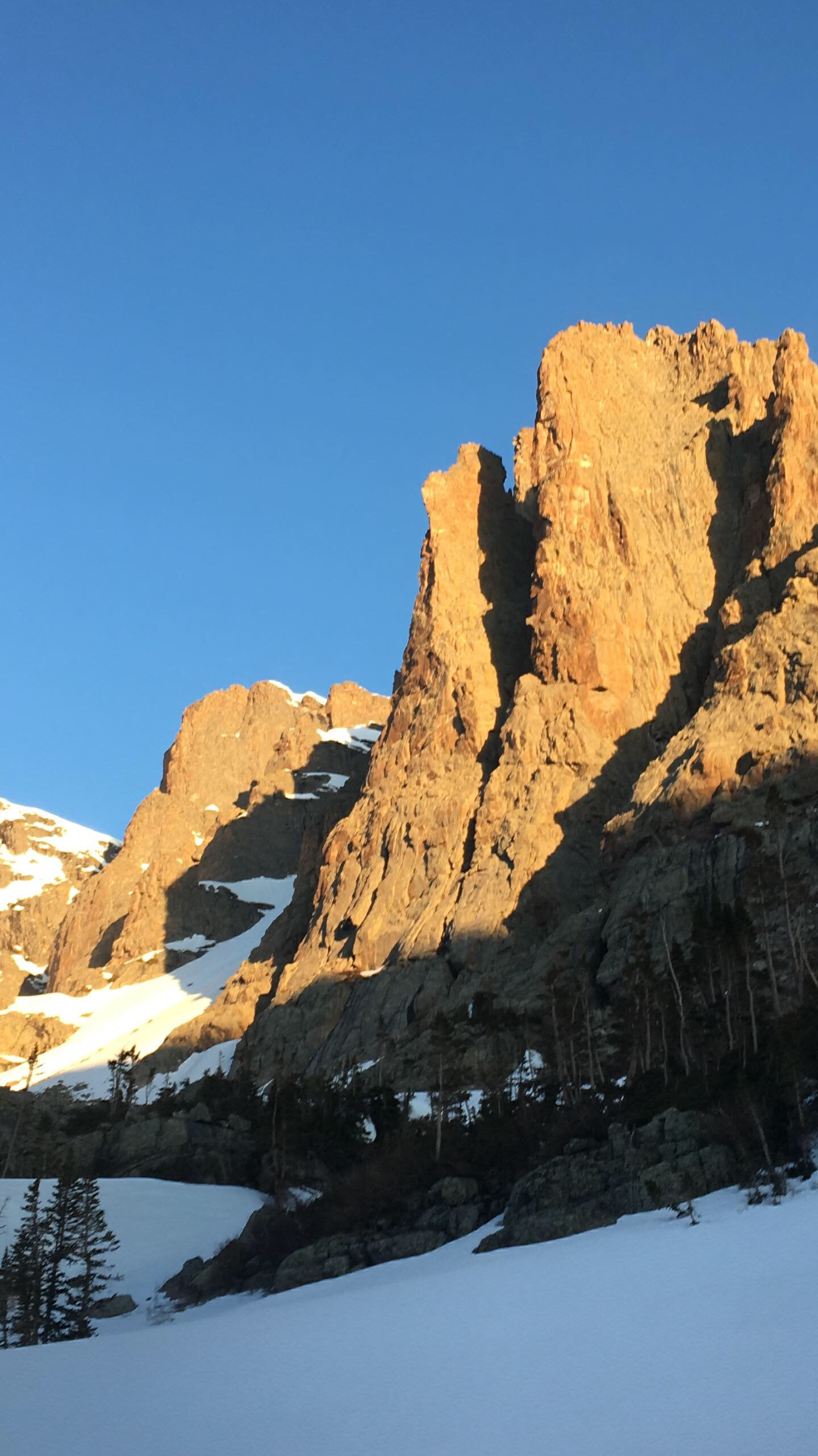 Petit Grepon Rocky Mountain National Park Rock Climb in dawn sunlight with snow June