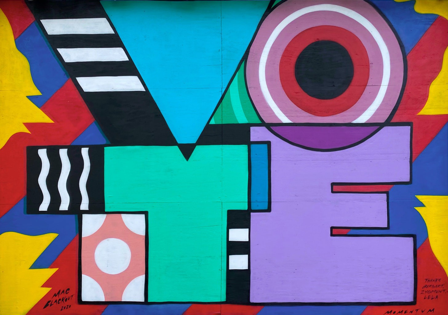Bright colored geometric mural of the word VOTE with VO at the top and TE at the bottom