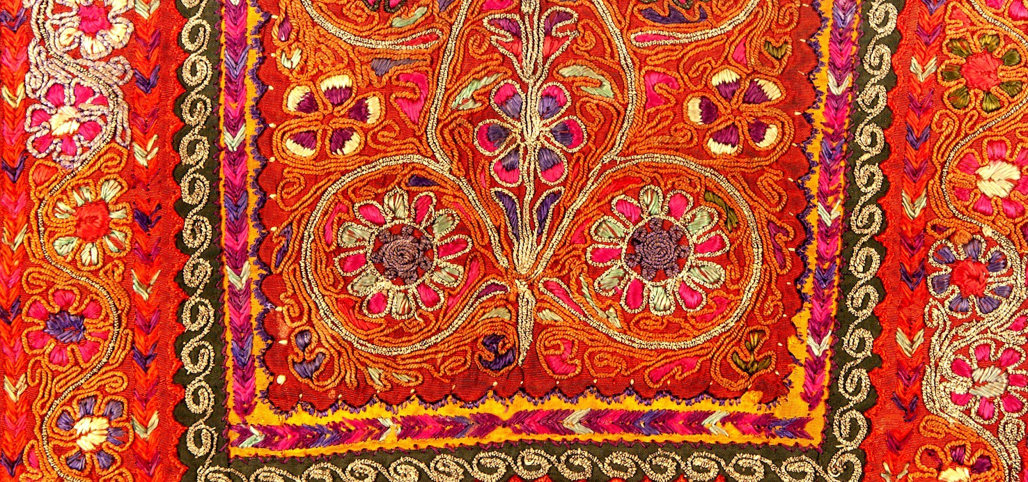 Close-up shot of intricate embroidery on a Palestinian thob (a kind of dress)