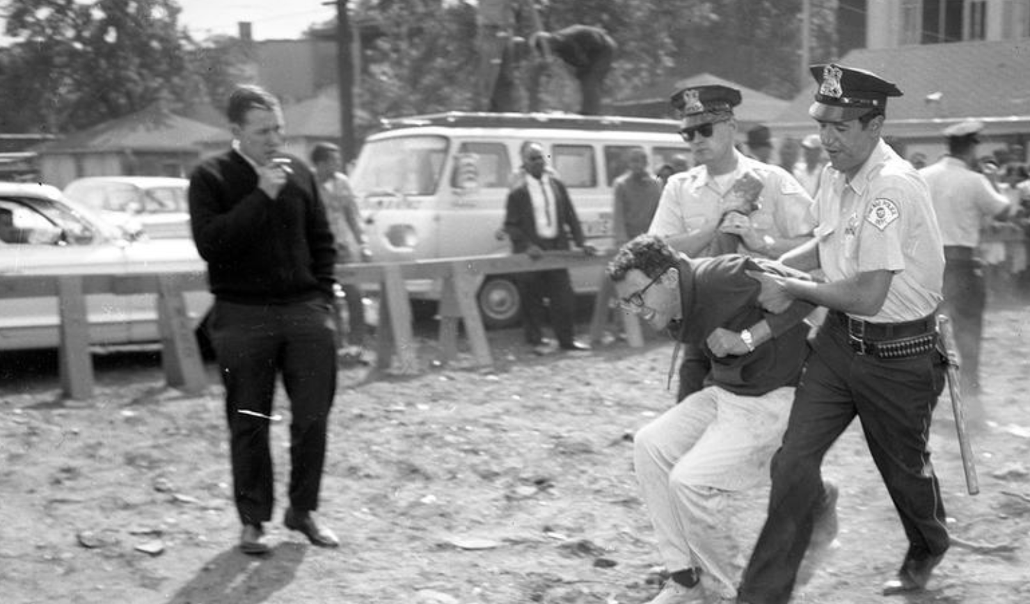 Picture of a young Bernie Sanders in 1963, getting arrested by Chicago police at a nonviolent protest.