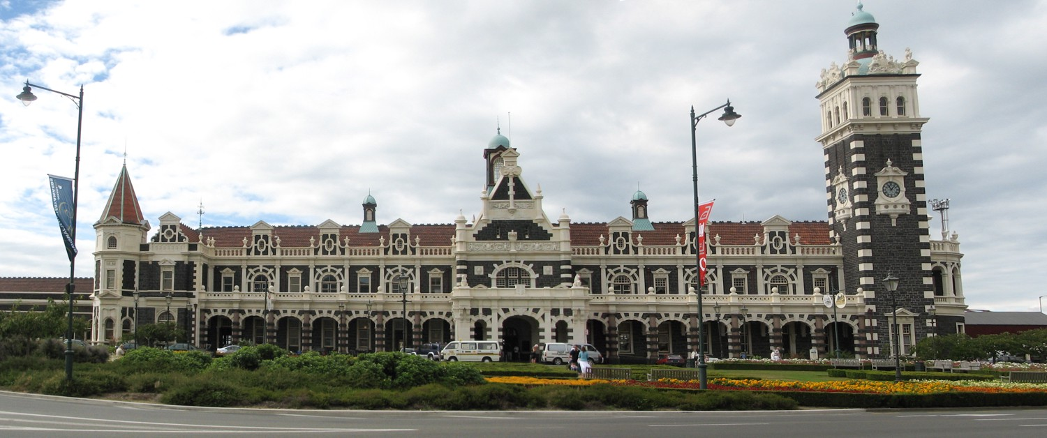 Same photograph of long ornate building with tower. Not so nice as the first one.