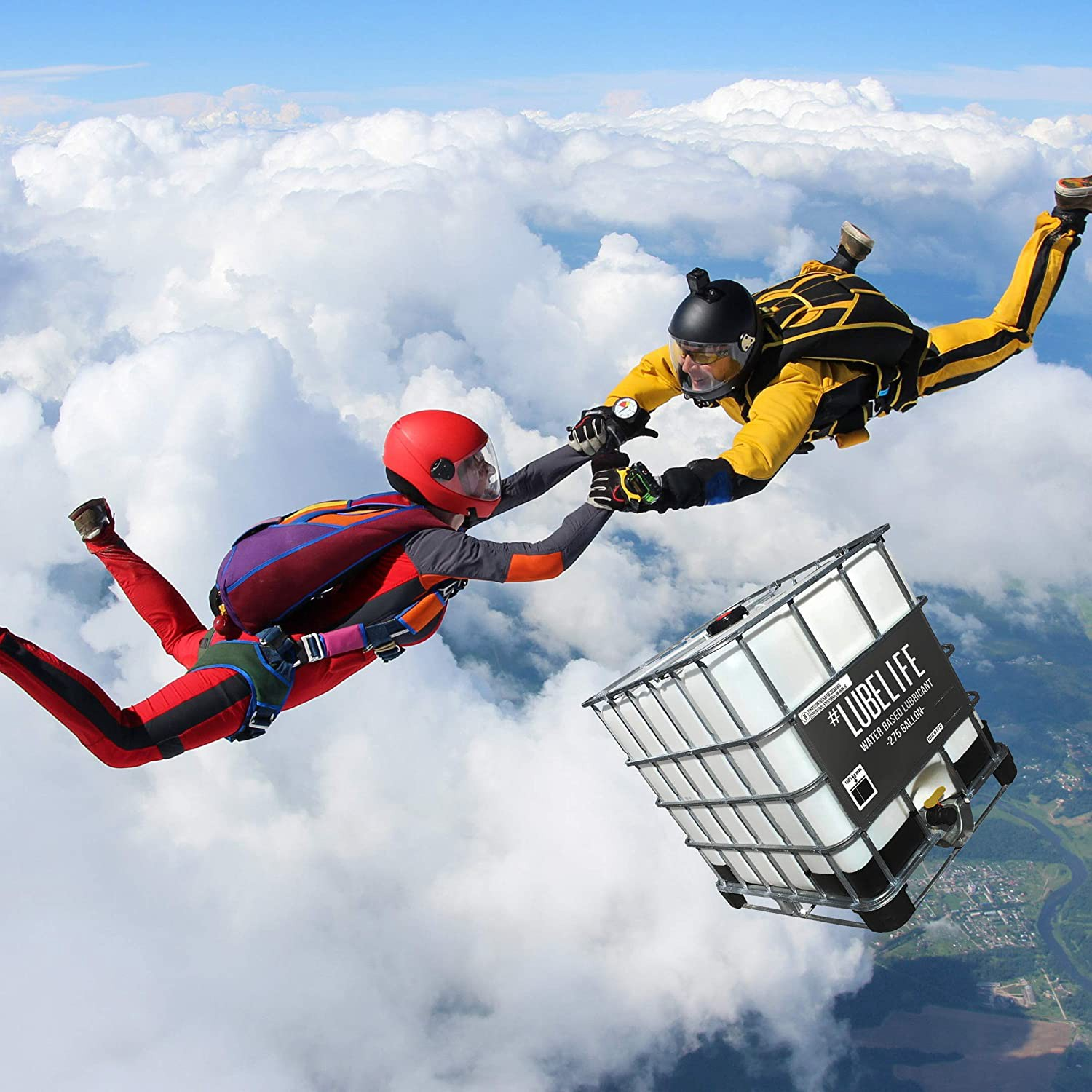 A man and a woman skydiving over a tub of lubricant.