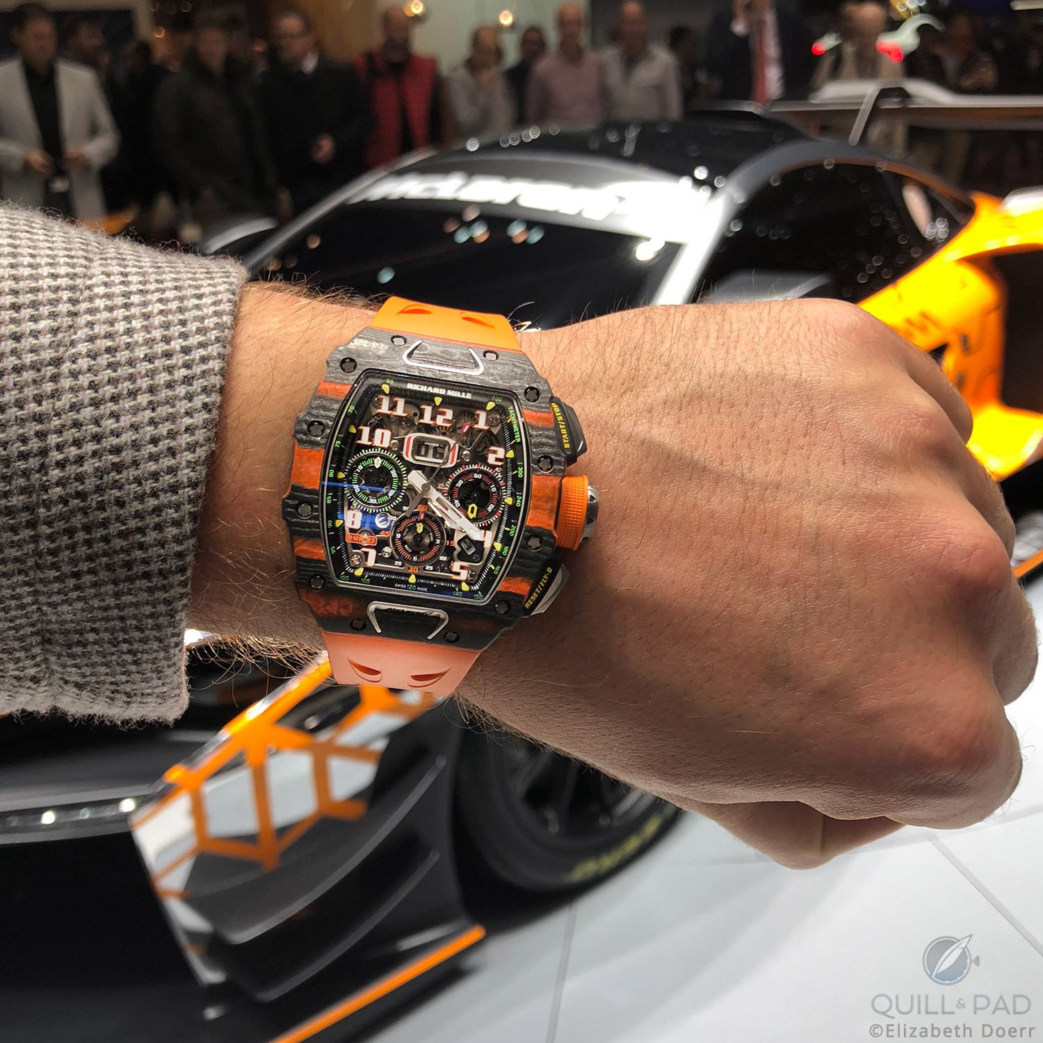 Richard Mille RM-11-03 McLaren Automatic Flyback Chronograph in front of the McLaren Senna GTR Concept at the 2018 Geneva Motor Show