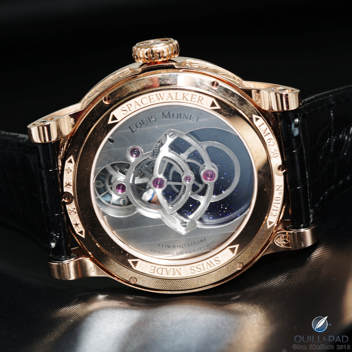View from the back of the open movement of the Louis Moinet Spacewalker to the scintillating adventurine galaxy beyond