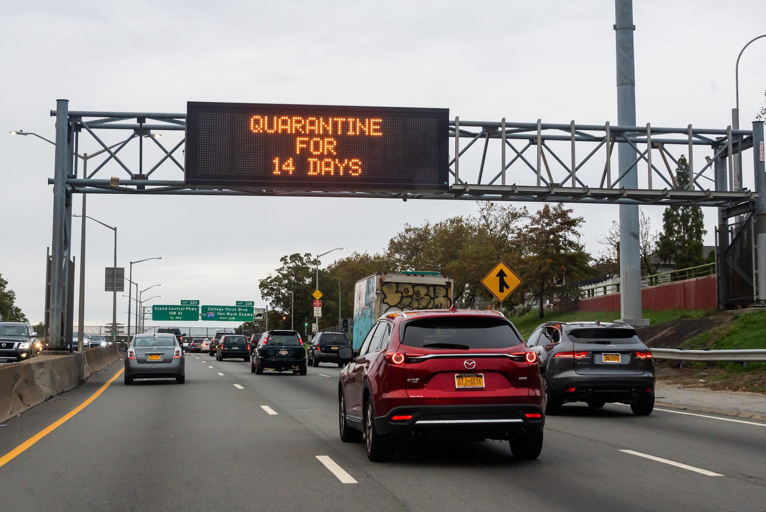 "A traffic sign reads, ""quarantine for 14 days"" above a road in Brooklyn on October 25, 2020 in New York City."