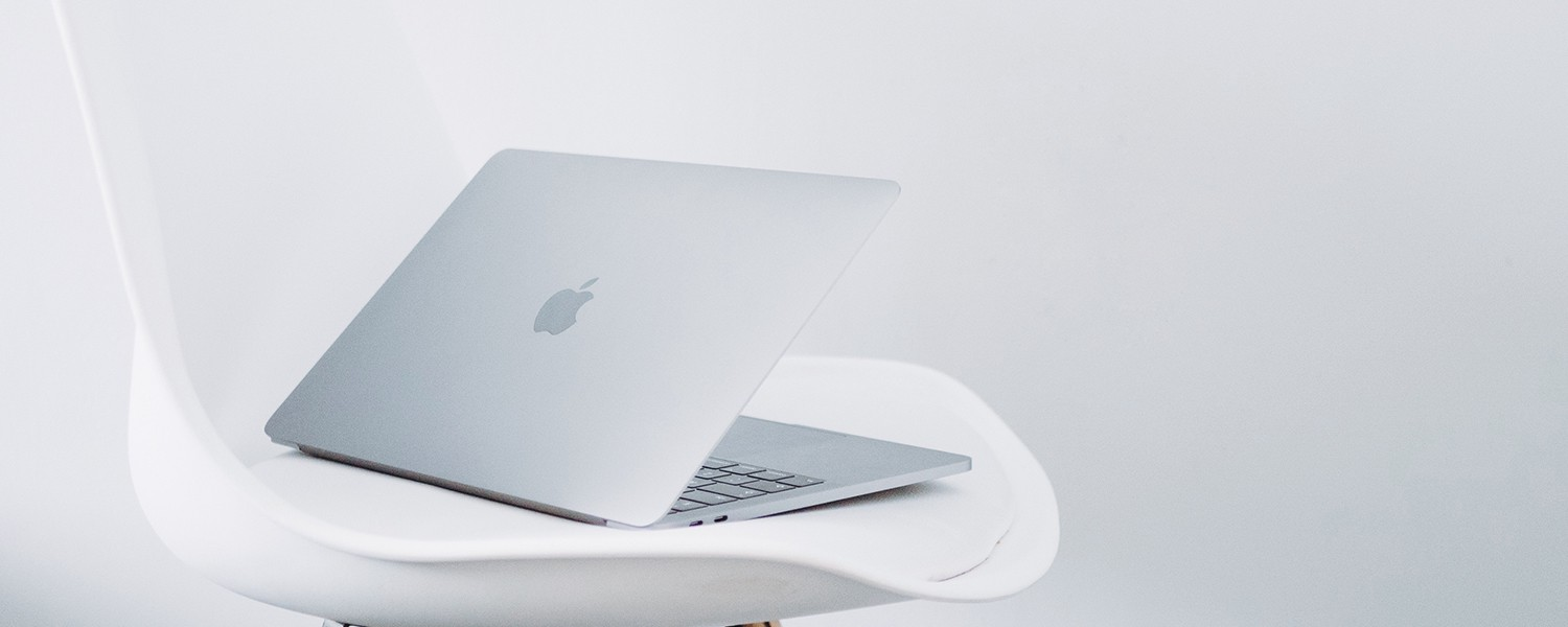 Laptop sitting on a white chair
