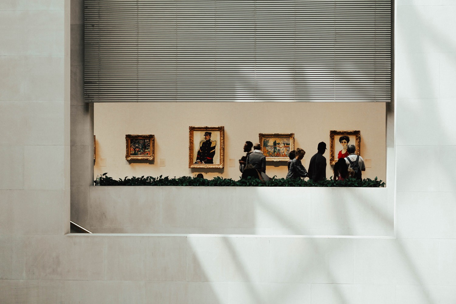 Museum visitors walking through a gallery