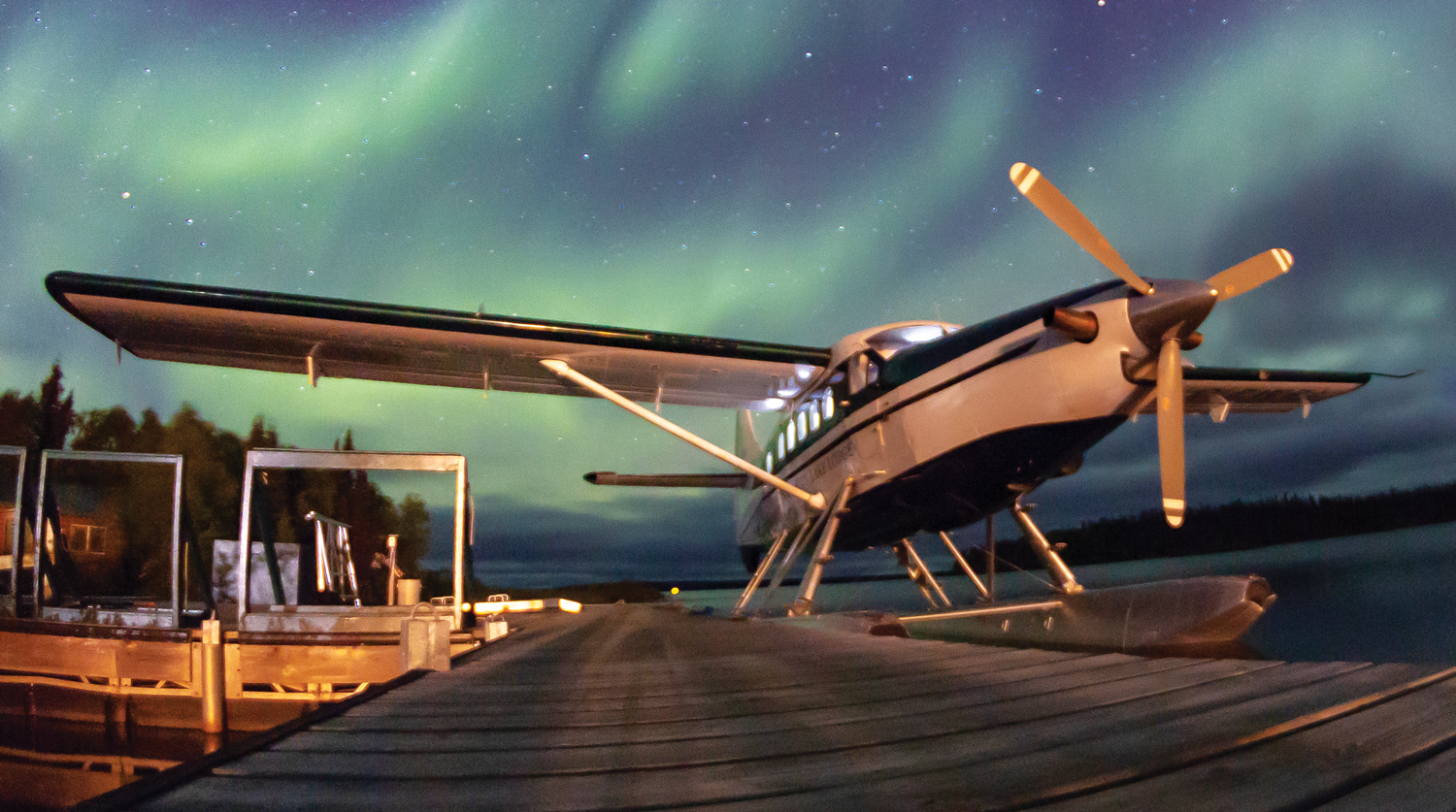 Photo of airplane and Northern Lights.