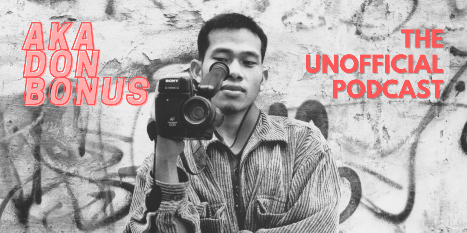 """A black and white image featuring Sokly Ny (AKA Don Bonus) pointing a camcorder back to the camera and looking through the viewfinder. On the top left of the image there is text that reads """"AKA DON BONUS"""" in pink, and on the right of the image is text that reads """"THE UNOFFICIAL PODCAST"""" in red."""